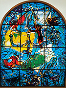 The Tribe of Dan. The Twelve Tribes of Israel depicted in stained glass By Marc Chagall (1887 - 1985). The Twelve Tribes are Reuben, Simeon, Levi, Judah, Issachar, Zebulun, Dan, Gad, Naphtali, Asher, Joseph, and Benjamin.