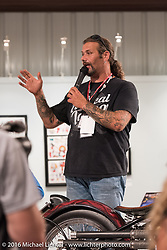 Chris Callen talks about his custom Board Stiff at the media meet and greet on the Industry party night for Michael Lichter's tattoo themed Skin & Bones Motorcycles as Art exhibition at the Buffalo Chip during the annual Sturgis Black Hills Motorcycle Rally.  SD, USA.  August 7, 2016.  Photography ©2016 Michael Lichter.