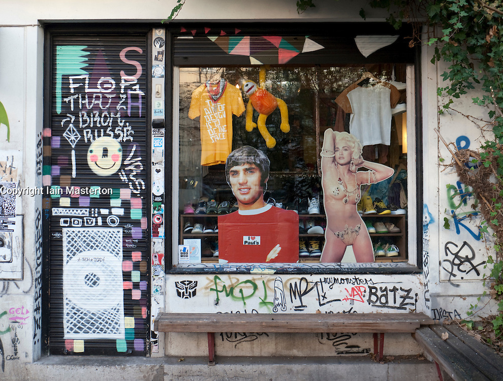 Detail of window display and graffiti on walls of trendy fashion boutique in bohemian district of Prenzlauer Berg in Berlin Germany