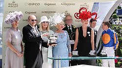Sophie Countess of Wessex (left) alongside winning owner Michael Tabor with the an award for Magic Wand winning the Ribblesdale Stakes during day three of Royal Ascot at Ascot Racecourse.. PRESS ASSOCIATION Photo. Picture date: Thursday June 21, 2018. See PA story RACING Ascot. Photo credit should read: John Walton/PA Wire. RESTRICTIONS: Use subject to restrictions. Editorial use only, no commercial or promotional use. No private sales.