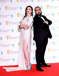 Aisling Bea and Asim Chaudhry in the press room at the 73rd British Academy Film Awards held at the Royal Albert Hall, London.