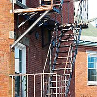 Red brick apartment building's fire escape in Damariscotta, Maine.