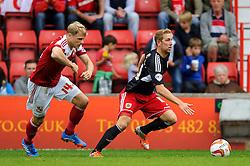 Bristol City Midfielder Scott Wagstaff (ENG) is challenged by Swindon Defender James McEveley (SCO) during the second half of the match - Photo mandatory by-line: Rogan Thomson/JMP - Tel: 07966 386802 - 21/09/2013 - SPORT - FOOTBALL - County Ground, Swindon - Swindon Town v Bristol City - Sky Bet League 1.
