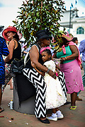 """30174109A LOUISVILLE, KY. - MAY 2, 2015: Tawonna Kieth-Davis, 6, of Chicago, middle-right, embraces her godmother, Nancie Davis during the 141st running of the Kentucky Derby at Churchill Downs. This was Kieth-Davis's first derby and Davis's 33rd. """"She cries every time I come so this year I brought her,"""" Davis said.<br /> <br /> William DeShazer for The New York Times"""