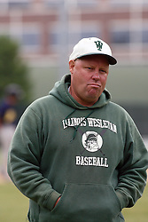 28 April 2012:  Coach Dennis Martel during an NCAA division 3 Baseball game between the Augustana Vikings and the Illinois Wesleyan Titans in Jack Horenberger Stadium, Bloomington IL