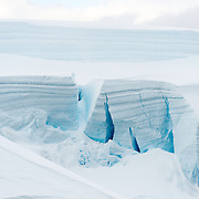 A large wall of blocks of glacier ice with large crevasses at Paradise Harbor on the Antarctic Peninsula.