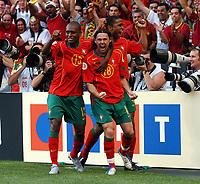 Stadio da Luz LISBON PORTUGAL 16/06/04  RUSSIA  V PORTUGAL  EURO 2004<br />MANICHE (PORTUGAL) CELEBRATES FIRST GOAL<br />Photo Roger Parker Fotosports International