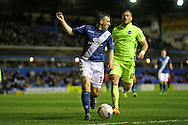 Birmingham City defender Paul Caddis (31) and Brighton striker, Tomer Hemed (10) during Birmingham City and Brighton and Hove Albion at St Andrews, Birmingham, England on 5 April 2016.