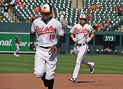 August 23, 2017 - Baltimore, MD, USA - The Baltimore Orioles' Trey Mancini, right, rounds the bases after his three-run home run, driving in Adam Jones, left, and Jonathan Schoop, not pictured, ahead of him in the fourth inning against the Oakland Athletics at Oriole Park at Camden Yards in Baltimore on Wednesday, Aug. 23, 2017. The Orioles won, 8-7, in 12 innings. (Credit Image: © Kenneth K. Lam/TNS via ZUMA Wire)