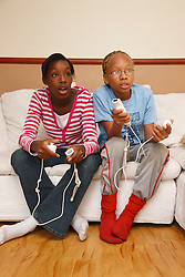 Brother and sister playing wii game