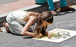 A young girl leaves her mark on King Langalibalele Street during the Open Streets Langa event on 30 October 2016, when the street was closed to motorised vehicles and opened to people. Hosted by Open Streets Cape Town and supported by the City of Cape town and WWF. photo by John Tee/RealTime Images.