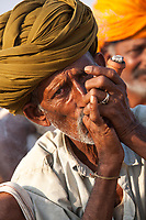 """Man with chillum, Pushkar, India<br /> Available as Fine Art Print in the following sizes:<br /> 08""""x12""""US$   100.00<br /> 10""""x15""""US$ 150.00<br /> 12""""x18""""US$ 200.00<br /> 16""""x24""""US$ 300.00<br /> 20""""x30""""US$ 500.00"""
