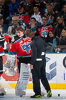 KELOWNA, CANADA - MARCH 18: Scott Hoyer, athletic therapist checks Jackson Whistle #1 of Kelowna Rockets after he gets up off the ice after a collision with a player of the Seattle Thunderbirds on March 18, 2015 at Prospera Place in Kelowna, British Columbia, Canada.  (Photo by Marissa Baecker/Shoot the Breeze)  *** Local Caption *** Jackson Whistle; Scott Hoyer;