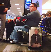 How to never pick up the wrong suitcase again: One passenger finds a hilarious solution to the age old problem<br /> <br /> The fear of losing your suitcase when you fly can fill many travellers with dread. <br /> But forget fancy luggage tags and coloured straps, one man decided to use a simple but effective method - and his idea has been making the rounds online. <br /> The inventive flyer was snapped with a personalised suitcase bearing his face, presumably so he would never again be in doubt which luggage was his. <br /> <br /> The full length image of the unidentified man spanned the entire length of the case, although it is not clear if it was featured on both sides. <br /> The picture of the man, who appears to be at an airport,<br /> One praised the quirky idea: 'This man knows what life really is all about.'<br /> Another said: 'His luggage will never be stolen.' But others pointed out flaws in the plan. <br /> 'If a thief looks kinda like him, it will be super easy for him to get away with it,' one user mused. <br /> 'That won't stop the airline from shipping it to the wrong airport,' another commented.<br /> However one thing is for certain, no one will mistake the man's luggage for theirs when pulling it out of an overhead bin on a plane.   <br /> ©Exclusivepix Media