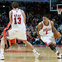 11 December 2009: Chicago Bulls guard Derrick Rose drives to the basket while Chicago Bulls center Joakim Noah sets a screen during the Chicago Bulls victory 96-91 in overtime over the Golden State Warriors at the United Center, in Chicago, Illinois, USA.