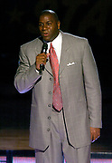 Magic Johnson speaks at the NBA All-Star Game on Sunday, Feb. 15, 2004 at the Staples Center on Sunday, Feb. 15, 2004 in Los Angeles.