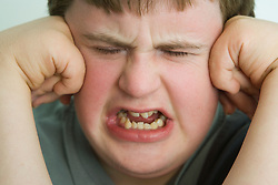 Young boy with Down's Syndrome; upset,