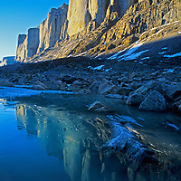 Midnight sun on the Sail Peaks reflects in a lake in the Stewart Valley, north of the Arctic Circle on Baffin Island, Nunavut, Canada.