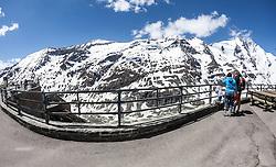 THEMENBILD - die Grossglockner Hochalpenstrasse. Die hochalpine Gebirgsstrasse verbindet die beiden oesterreichischen Bundeslaender Salzburg und Kaernten mit einer Laenge von 48 Kilometer. Sie ist als Erlebnisstrasse vorrangig von touristischer Bedeutung und das Befahren ist fuer Kraftfahrzeuge mautpflichtig, im Bild Besucherzentrum Kaiser-Franz-Josefs-Höhe mit Blick auf den Grossglockner und seinen umliegenden Bergen, aufgenommen am 24.05.2014 // ILLUSTRATION - the Grossglockner High Alpine Road. The high alpine mountain road connects the two Austrian federal states of Salzburg and Carinthia with a length of 48 kilometers. It is as a matter of priority road experience of tourist importance and for driving motor vehicles is a toll road. Picture taken on 2014/05/24. EXPA Pictures © 2014, PhotoCredit: EXPA/ JFK