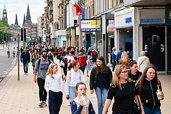 Edinburgh, Scotland, UK. 2 July, 2020. Good weather brought many shoppers out onto Princes Street in Edinburgh. Still busy with people queuing around the block was Primark. Pictured; Princes Street busy with people out shopping.  Iain Masterton/Alamy Live News