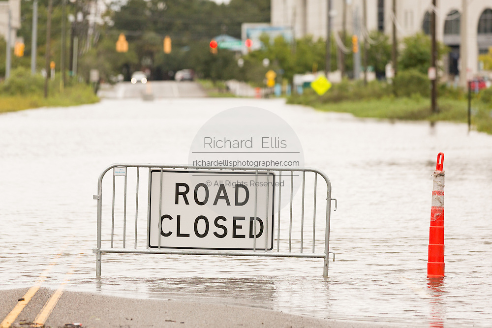 A road closed sign at a severely flooded street as Hurricane Joaquin brings heavy rain, flooding and strong winds as it passes offshore October 4, 2015 in Charleston, South Carolina.