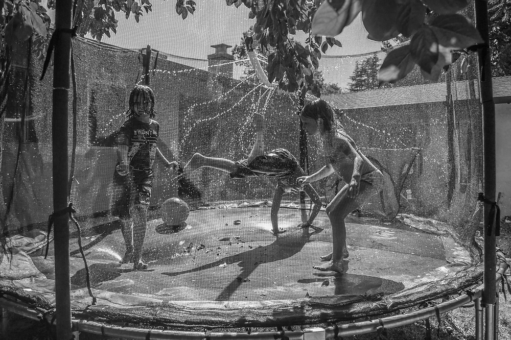 Six minutes of water...neighbor kids take a short break from the summer heat in Calistoga.
