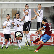 Besiktas's (L-R) Oguzhan Ozyakup, Olcay Sahan, Hugo Miguel Pereira de Almeida, Filip Holosko and Trabzonspor's Olcan Adin (R) during their Turkish Superleague soccer derby match Besiktas between Trabzonspor at the Inonu Stadium at Dolmabahce in Istanbul Turkey on Sunday, 21 October 2012. Photo by Aykut AKICI/TURKPIX