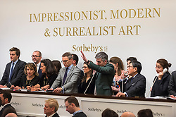 © Licensed to London News Pictures. 26/02/2019. LONDON, UK. Sotheby's staff take telephone bids at Sotheby's Impressionist, Modern and Surrealist Art Evening Sale in New Bond Street.  Photo credit: Stephen Chung/LNP