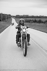 Alan Stulberg of Revival Cycles in Austin takes a spin on Sean Duggan's 1936 Harley-Davidson Knucklehead chopper during stage 6 of the Motorcycle Cannonball Cross-Country Endurance Run, which on this day ran from Cape Girardeau to Sedalia, MO., USA. Wednesday, September 10, 2014.  Photography ©2014 Michael Lichter.