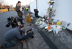© Licensed to London News Pictures. 06/01/2012. Salford, UK. Media film the shrine that's been built at the location of Anuj Bidve's murder. Photo credit : Joel Goodman/LNP