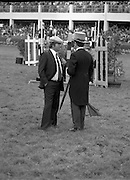 Aga Khan Trophy..1979..10.08.1979..08.10.1979..10th August 1979..The annual staging of the Aga Khan Cup took place  at the Royal Dublin Showgrounds, Ballsbridge,Dublin today.It was the first time since 1937 that Ireland won the trophy outright. The winning Irish team comprised of Paul Darragh,Capt Con Power,James Kernan and Eddie Macken..A course offical and a cameraman discuss the events of the day.