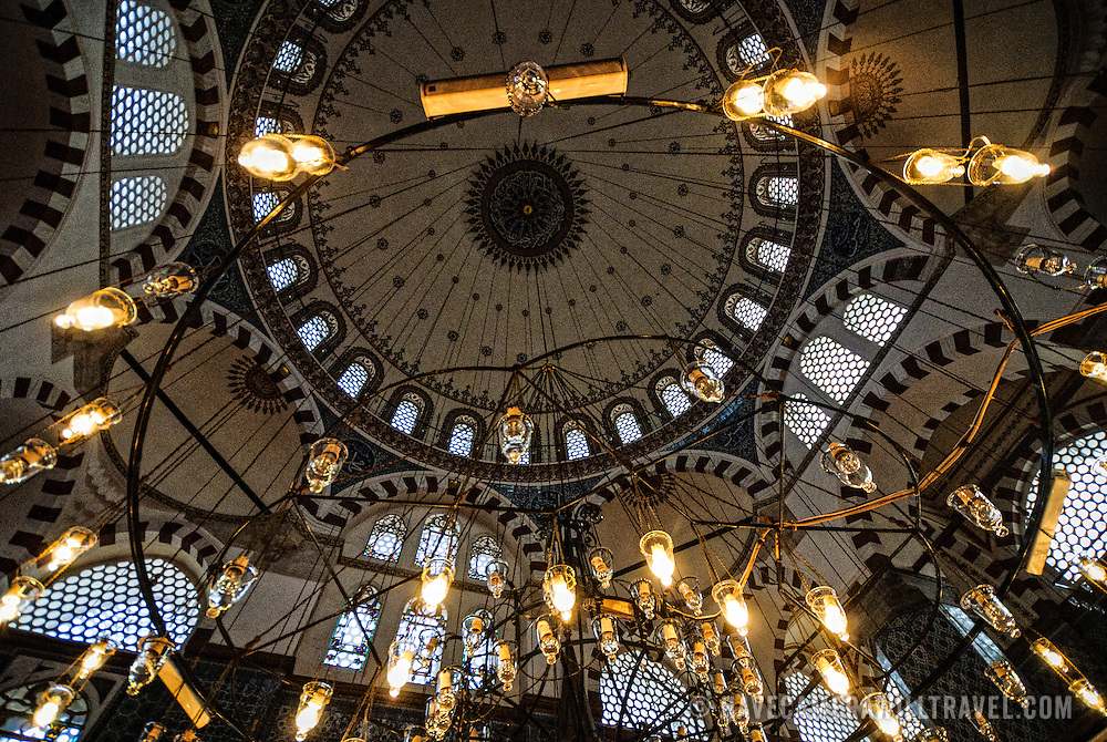Looking up at the ceiling dome through suspended lights of Istanbul's Rustem Pasha Mosque near the Spice (Egyption) Market.