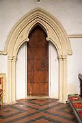 Village parish church Holbrook, Suffolk, England, UK moulded trefoil archway c13th century
