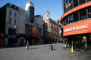 Leicester Square almost deserted due to the Covid-19 outbreak social distancing on what would normally be a busy, bustling day with hoards of people out to shop and socialise on 22nd March 2020 in London, England, United Kingdom. Coronavirus or Covid-19 is a new respiratory illness that has not previously been seen in humans. While much or Europe has been placed into lockdown, the UK government has announced more stringent rules as part of their long term strategy, and in particular social distancing.