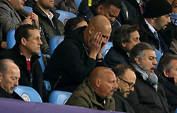 Manchester City manager Pep Guardiola reacts in the stands after Liverpool's Roberto Firmino scores a goal