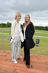Left to right, sisters EDIE CAMPBELL and OLYMPIA CAMPBELL at the Audi Polo Challenge at Coworth Park, Blacknest Road, Ascot, Berkshire on 31st May 2015.