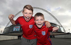 Young England fans Oliver and Lenny from the Isle of Wight before the 2018 FIFA World Cup Qualifying, Group F match at Wembley Stadium, London.