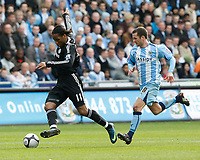 Photo: Steve Bond/Richard Lane Photography.<br />Coventry City v Chelsea. FA Cup 6th Round. 07/03/2009. Didier Drogba (L) controls the ball in front of Michael Doyle