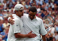 Roger Federer (Switzerland) hugs Andy Roddick (USA) after beating him in the Semi-Final. Wimbledon Tennis Championship, Day 11, 4/07/2003. Credit: Colorsport / Matthew Impey DIGITAL FILE ONLY