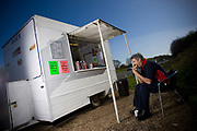 Rory Campbell eating a breakfast sandwich at Angie's Big Baps burger van at a roadside layby along the westbound A47 on the 27th April 2010 in Easton in the United Kingdom.