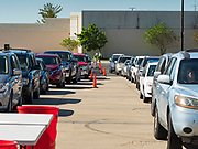 29 MAY 2020 - DES MOINES, IOWA: People lined up in their car for a produce distribution in a mall parking lot in Des Moines. The Des Moines Area Religious Council (DMARC) and Capitol City Fruit from Norwalk, IA, gave away 1,800 boxes of fresh produce with a mix of vegetables and fruit. The boxes contain enough produce to feed a family of four for a week. The produce was provided by the USDA Farmers to a Families food program. Because of the COVID-19 pandemic, the unemployment rate in Iowa hit 10.2% in May, the highest unemployment rate ever recorded in Iowa and food insecurity in Iowa is impacting communities throughout the state.         PHOTO BY JACK KURTZ