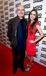 """File photo dated 16/06/08 of Phil Collins with his daughter Lily, who says she has forgiven her famous father for """"not being the dad I expected""""."""