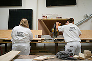 """COLUMBIANA, AL – JUNE 25, 2015: <br /> Female residents learn carpentry skills in the wood shop at the Alabama Therapeutic Education Facility. <br /> The Alabama Therapeutic Education Facility in Columbiana, Alabama has operated under contract with the Department of Corrections since 2008. The facility represents an alternative to the state's overcrowded corrections facilities and an attempt to """"break the cycle of recidivism"""" among inmates through a combination of positive messaging and educational opportunities. """"We're more focused on changing behavior than controlling it,"""" said Gary Hetzel, director of the facility. <br />  ATEF is owned and operated by Community Education Centers, a """"reentry treatment and education services provider"""" based in New Jersey that is currently operating in 16 states. In stark contrast to most medium custody prisons, ATEF is air conditioned, and each room boasts a telephone and private bath. Post-secondary education is offered to all """"residents"""" who are then required to have a GED before leaving the facility. Correctional Officers, called """"operations counselors"""" lead residents in vocational training and certification opportunities through partnership with the local J.F. Ingram Community College. The facility also provides specific anger and stress management programs when prescribed by judges on a case by case basis. <br /> But not all inmates are given the opportunity to serve time at ATEF. The Alabama Department of Corrections makes a determination of eligibility upon sentencing based on the severity of a crime, and most ATEF """"residents"""" are int the final stages of a sentence and preparing for work release.<br /> """"It generally takes 4-6 weeks for DOC inmate who gets transferred here to adjust to the place,"""" said Gary Hetzel, director of the facility.""""Some residents say the place saved their life."""" Currently ATEF is the only facility of its kind run in the state of Alabama.<br /> CREDIT: Bob Miller for The Daily Signal"""