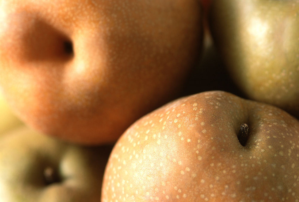 Close up selective focus photograph of some Asian pears