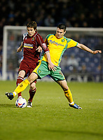 Photo: Paul Greenwood.<br />Burnley v Norwich City. Coca Cola Championship. 17/04/2007.<br />Norwich's Jason Shackell, (R) gets the better of Wade Elliott