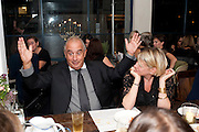 SIR PHILIP GREEN; FIONA GOLFAR, Leaving dinner for Kate Phelan given by Alex Shulman and Mary Homer. Riding House Cafe. Great Titchfield st. London. 20 September 2011. <br /> <br />  , -DO NOT ARCHIVE-© Copyright Photograph by Dafydd Jones. 248 Clapham Rd. London SW9 0PZ. Tel 0207 820 0771. www.dafjones.com.