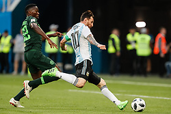 June 26, 2018 - Saint Petersburg, Russia - Kenneth Omeruo of Nigeria national team defends as Lionel Messi of Argentina national team shoots to score a goal during the 2018 FIFA World Cup Russia group D match between Nigeria and Argentina on June 26, 2018 at Saint Petersburg Stadium in Saint Petersburg, Russia. (Credit Image: © Mike Kireev/NurPhoto via ZUMA Press)