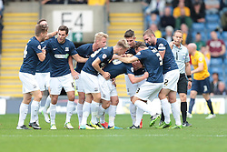 Southend United's Connor Clifford is mobbed after scoring Southend's first goal - Photo mandatory by-line: Nigel Pitts-Drake/JMP - Tel: Mobile: 07966 386802 05/10/2013 - SPORT - FOOTBALL - Kassam Stadium - Oxford - Oxford United v Southend United - Sky Bet League 2