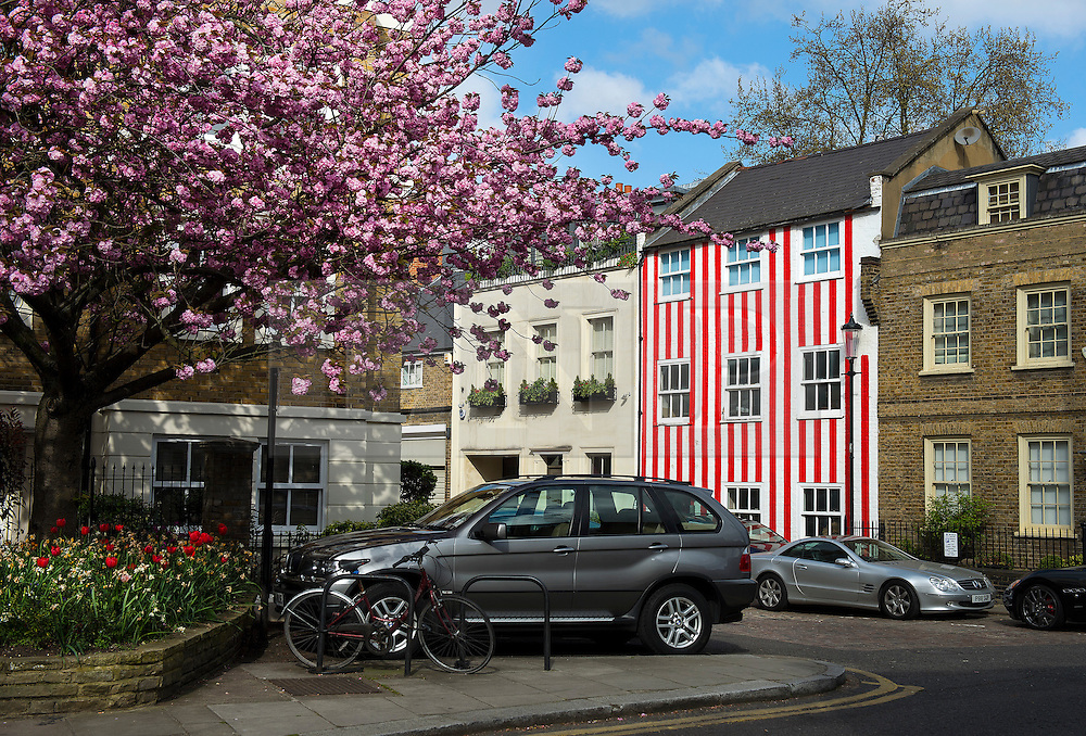 © London News Pictures. 18/04/2015. A house painted with red and white stripes in the Kensington area of west London. The candy stripes were painted on to the multi-million pound house following a dispute in which  neighbours objected to plans to demolish the building and replace it with a new house and two-storey basement. Photo credit: Ben Cawthra/LNP