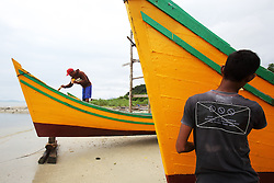 Fishermen repairing and repainting boats in Lhok seudu Village port. Oxfam had built shelter following the Indian Ocean Tsunami of Dec 2004, District Aceh Besar, Aceh Province, Sumatra, Indonesia